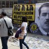 "Photo - People walk past a banner that shows an image of the late Mexican President Lazaro Cardenas with a message that reads in Spanish; ""No to oil privatization,"" during a rally hosted by the Party of the Democratic Revolution. AP Photo/Eduardo Verdugo) <strong>Eduardo Verdugo</strong>"