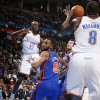 Oklahoma City\'s Reggie Jackson (15) passes the ball around New York\'s Jared Jeffries (9) during the NBA game between the Oklahoma City Thunder and the New York Knicks at Chesapeake Energy Arena in Oklahoma CIty, Saturday, Jan. 14, 2012. Photo by Bryan Terry, The Oklahoman