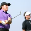 Photo - Phil Mickelson of the US watches his shot off the 8th tee as Bubba Watson of the US takes a drink during the first day of the British Open Golf championship at the Royal Liverpool golf club, Hoylake, England, Thursday July 17, 2014. (AP Photo/Scott Heppell)