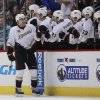 Photo - Anaheim Ducks defenseman Ben Lovejoy, far left, is congratulated after his goal by teammates while facing the Colorado Avalanche in the second period of an NHL hockey game in Denver on Friday, March 14, 2014. (AP Photo/David Zalubowski)