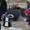 A baby girl plays near the \'Banker\' character of a big-scale Monopoly game set up at the anti-corporate protest tent camp outside St Paul\'s Cathedral, in central London, Thursday, Nov. 3, 2011. Asian stock markets fell Thursday for the fourth straight day as a European deal to bail Greece out of its financial mess appeared to be on the verge of unraveling. Greece\'s prime minister unexpectedly announced Monday that he would call a national vote on the European bailout plan that entails painful tax increases and drastic welfare cuts in exchange for massive aid to keep his debt-ridden nation solvent. (AP Photo/Lefteris Pitarakis) ORG XMIT: LLP108