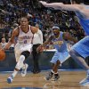 Oklahoma City\'s Russell Westbrook (0) drives the ball up the court past Denver\'s Ty Lawson (3) during the NBA preseason basketball game between the Oklahoma City Thunder and the Denver Nuggets at the Chesapeake Energy Arena, Sunday, Oct. 21, 2012. Photo by Garett Fisbeck, The Oklahoman