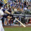 Photo - Milwaukee Brewers' Mark Reynolds hits a two-run home run during the fifth inning of a baseball game against the Minnesota Twins, Monday, June 2, 2014, in Milwaukee. (AP Photo/Morry Gash)