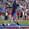 KU\'s Trevor Pardula (16) kicks the ball out of the end zone for a safety during of the college football game between the University of Oklahoma Sooners (OU) and the University of Kansas Jayhawks (KU) at Memorial Stadium in Lawrence, Kan., Saturday, Oct. 19, 2013. OU won 34-19. Photo by Sarah Phipps, The Oklahoman