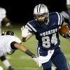 Edmond North\'s Jarech Page tries to past Midwest City\'s Jordan Huff during their high school football game at Wantland Stadium in Edmond, Thursday, October 25, 2012. Photo by Bryan Terry, The Oklahoman