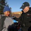 Iditarod musher Jeff King, from Denali, Alaska, signs the jacket of Ben Homekingkeo at the Koyuk checkpoint during the 2014 Iditarod Trail Sled Dog Race on Sunday, March 9, 2014 in Koyuk, Alaska. (AP Photo/The Anchorage Daily News, Bob Hallinen)