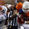 Oklahoma State\'s Austin Hays (84) fights off Savannah State\'s Edward Baety (48) during a college football game between Oklahoma State University (OSU) and Savannah State University at Boone Pickens Stadium in Stillwater, Okla., Saturday, Sept. 1, 2012. Photo by Sarah Phipps, The Oklahoman