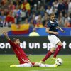 Photo - France's Karim Benzema, right, controls the ball past Spain's Sergio Ramos during their international friendly soccer match at the Stade de France in Saint Denis, outside Paris, Thursday, Sept. 4, 2014. (AP Photo/Christophe Ena)