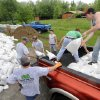 Volunteers empty sandbags from the back of a pick-up truck in Metropolis, Ill. Wednesday, April 27, 2011. With five days of heavy rainfall and more to come, volunteers filling sandbags Wednesday in southern Illinois towns threatened by the swollen Ohio River braced for possible record flooding. Officials asked for more volunteers to help with the effort. (AP Photo/The Southern, Steve Jahnke)