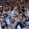 Muslim Brotherhood and Egyptian President Morsi supporters carry a body of one of six victims who were killed during Wednesday\'s clashes during their funeral outside Al Azhar mosque, the highest Islamic Sunni institution, Friday, Dec. 7, 2012. During the funeral, thousands Islamist mourners chanted,