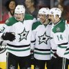 Dallas Stars\' Tyler Seguin, centre, celebrates his goal with teamates Valeri Nichushkin, left, from Russia, and Jamie Benn during third period NHL hockey action against the Calgary Flames in Calgary, Alta., Thursday, Nov. 14, 2013. The Dallas Stars beat the Calgary Flames 7-3. (AP Photo/The Canadian Press, Jeff McIntosh)