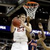 OU\'s Blake Griffin grabs a rebound beside Morgan State\'s Reggie Holmes during a first round game of the men\'s NCAA tournament between Oklahoma and Morgan State in Kansas City, Mo., Thursday, March 19, 2009. PHOTO BY BRYAN TERRY, THE OKLAHOMAN
