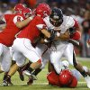 Coweta\'s Randall Smith is stopped by a gang of Carl Albert defenders during a high school football game at Carl Albert in Midwest City, Friday, September 7, 2012. Photo by Bryan Terry, The Oklahoman