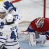 Toronto Maple Leafs\' James van Riemsdyk, left, celebrates with teammate Tyler Bozak after scoring against Montreal Canadiens goaltender Carey Price during the second period of an NHL hockey game in Montreal, Saturday, Feb. 9, 2013. (AP Photo/The Canadian Press, Graham Hughes)