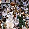 Miami Heat forward LeBron James (6) comes down with a rebound against Milwaukee Bucks guard Ish Smith (15) and guard Brandon Jennings (3) during the second half of Game 2 in their first-round NBA basketball playoff series, Tuesday, April 23, 2013 in Miami. The Heat defeated the Bucks 98-86. (AP Photo/Wilfredo Lee)