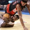 Oklahoma City\'s Serge Ibaka gets a loose ball despite pressure from Toronto\'s Antoine Wright during their NBA basketball game at the Ford Center in Oklahoma City on Sunday, Feb. 28, 2010. Photo by John Clanton, The Oklahoman