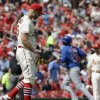 Photo - Chicago Cubs' Starlin Castro, right, rounds the bases after hitting a solo home run off St. Louis Cardinals starting pitcher Justin Masterson, left, during the fifth inning in the first baseball game of a doubleheader, Saturday, Aug. 30, 2014, in St. Louis. (AP Photo/Jeff Roberson)