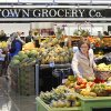 Sherri Nelson shops for produce Wednesday on the opening day of the new Uptown Grocery in Edmond. Photos by David McDaniel, The Oklahoman