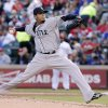 Photo - Seattle Mariners starting pitcher Felix Hernandez throws during the first inning of a baseball game against the Texas Rangers, Wednesday, April 16, 2014, in Arlington, Texas. (AP Photo/Brandon Wade)