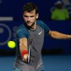 Photo - Bulgaria's Grigor Dimitrov returns the ball while playing against Britain's Andy Murray during a semi-final match of the Mexican Tennis Open in Acapulco, Mexico, Friday, Feb. 28, 2014. Murray lost in three sets to Dimitrov. (AP Photo/Jam Media- Hugo Avila)