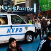 FILE - In this Dec. 31, 2011 file photo, pedestrians pass police vans in New York City's Times Square as city police officials begin ramping up security before New Year's Eve celebrations. The New York City police use an array of security measures for the event that turns the