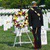Prince Harry of Britain lays a wreath at Section 60 of Arlington National Cemetery, where veterans of the wars in Iraq and Afghanistan are buried, in Virginia on May 10, 2013. (AP PHOTO/Nicholas Kamm, Pool)