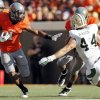 OSU\'s Joseph Randle (1) carries the ball as Tracy Moore (87) blocks Bryce Hager (44) of Baylor in the second quarter during a college football game between the Oklahoma State University Cowboys (OSU) and the Baylor University Bears (BU) at Boone Pickens Stadium in Stillwater, Okla., Saturday, Oct. 29, 2011. Photo by Nate Billings, The Oklahoman