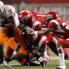 OSU\'s Michael Harrison fights off a group of Louisiana-Lafayette\'s defenders including Devon Lewis-Buchanan, top, and Lionel Stokes, right, during the football game between the University of Louisiana-Lafayette and Oklahoma State University at Cajun Field in Lafayette, La., Friday, October 8, 2010. Photo by Bryan Terry, The Oklahoman