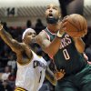 Milwaukee Bucks forward Drew Gooden (0) drives past Cleveland Cavaliers\' Daniel Gibson during the second quarter of a preseason NBA basketball game, Tuesday, Oct. 9, 2012, in Canton, Ohio. (AP Photo/David Richard)