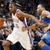 Oklahoma City\'s Kevin Durant (35) drives the ball past Shawn Marion (0) of Dallas in the first half during an NBA basketball game between the Oklahoma City Thunder and the Dallas Mavericks at Chesapeake Energy Arena in Oklahoma City, Thursday, Dec. 29, 2011. Photo by Nate Billings, The Oklahoman