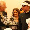 Oklahoma State football coach Mike Gundy is presented the Big 12 Championship trophy from Big 12 interim commissioner Chuck Neinas. PHOTO COURTESY OSU SPORTS INFORMATION