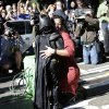 """Miles Scott, 5, dressed as Batkid, rescues a damsel in distress in San Francisco, Friday, Nov. 15, 2013. San Francisco turned into Gotham City on Friday, as city officials helped fulfill Scott\'s wish to be """"Batkid.""""Â Scott, a leukemia patient from Tulelake in far Northern California, was called into service on Friday morning by San Francisco Police Chief Greg Suhr to help fight crime, The Greater Bay Area Make-A-Wish Foundation says. (AP Photo/Bay Area News Group, Gary Reyes)"""