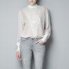 To get actress Keri Russell\'s look, try the embroidered blouse from Zara for $59.90. (Courtesy Zara.com via Los Angeles Times/MCT)
