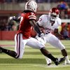 Oklahoma\'s DeMarco Murray (7) tries to get past Nebraska\'s Dejon Gomes (7) during the first half of the college football game between the University of Oklahoma Sooners (OU) and the University of Nebraska Cornhuskers (NU) on Saturday, Nov. 7, 2009, in Lincoln, Neb. Photo by Chris Landsberger, The Oklahoman