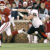 OU\'s Sam Bradford runs past Colby Whitlock of Texas Tech during the college football game between the University of Oklahoma Sooners and Texas Tech University at Gaylord Family -- Oklahoma Memorial Stadium in Norman, Okla., Saturday, Nov. 22, 2008. BY BRYAN TERRY, THE OKLAHOMAN