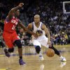 Golden State Warriors\' Jarrett Jack (2) drives against Philadelphia 76ers\' Jrue Holiday (11) during the second half of an NBA basketball game in Oakland, Calif., Friday, Dec. 28, 2012. Golden State won 96-89. (AP Photo/Marcio Jose Sanchez)