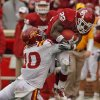 Oklahoma\'s Roy Finch (22) leaps to try and avoid the tackle of Iowa State\'s Jacques Washington (10) during the second half of a college football game in which the University of Oklahoma Sooners (OU) defeated the Iowa State University Cyclones (ISU) 26-6 at Gaylord Family-Oklahoma Memorial Stadium in Norman, Okla., Saturday, Nov. 26, 2011. Photo by Steve Sinsey, The Oklahoman