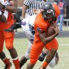 Douglass\' Shon Bridges outruns the tackle of Millwood\'s Josh Turner during the annual Soul Bowl between Millwood at Douglass in 2010. PAUL HELLSTERN - THE OKLAHOMAN