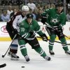 Photo - Dallas Stars center Cody Eakin (20) and Colorado Avalanche center Matt Duchene (9) compete for a loose puck as Stars defenseman Jamie Oleksiak (5) watches in the second period of a preseason NHL hockey game on Thursday, Sept. 26, 2013, in Dallas. (AP Photo/Tony Gutierrez)