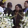 Stacey Jackson, second from right, the mother of Jerry Brown, and Dallas Cowboys football player Josh Brent, left, and an unknown persons leave after memorial service for Brown at Oak Cliff Bible Fellowship, Tuesday, Dec. 11, 2012, in Dallas. Brown, a member of the Cowboys practice squad, died in a suspected drunken-driving accident on Saturday. Brent was the driver and is charged with intoxication manslaughter. (AP Photo/LM Otero)
