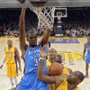 Oklahoma City Thunder forward Kevin Durant, left, dunks as Los Angeles Lakers forward Antawn Jamison defends during the first half of their NBA basketball game, Friday, Jan. 11, 2013, in Los Angeles. The Thunder won 116-101. (AP Photo/Mark J. Terrill)
