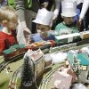 Five-year-old Parker Thornton (left) and three-year-olds Jacob Thornton and Peter Craig watch the trains during the annual Oklahoma City Train Show in the Travel and Transportation Building at State Fair Park in Oklahoma City, OK, Saturday, Dec. 4, 2010. By Paul Hellstern, The Oklahoman