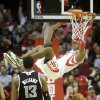Photo - Houston Rockets guard Dwight Howard dunks the ball past Sacramento Kings forward Derrick Williams (13) during the second quarter of an NBA basketball game, Wednesday, Jan. 22, 2014, in Houston. (AP Photo/Patric Schneider)