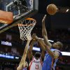 Oklahoma City\'s Thabo Sefolosha (2) and Oklahoma City\'s Serge Ibaka (9) defend Houston\'s James Harden (13) during Game 4 in the first round of the NBA playoffs between the Oklahoma City Thunder and the Houston Rockets at the Toyota Center in Houston, Texas,Sunday, April 29, 2013. Oklahoma City lost 105-103. Photo by Bryan Terry, The Oklahoman