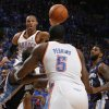 Oklahoma City\'s Russell Westbrook (0) passes the ball near O.J. Mayo (32), right, of Memphis as Oklahoma City\'s Kendrick Perkins (5) is guarded by Zach Randolph (50) of Memphis in the first half during game 7 of the NBA basketball Western Conference semifinals between the Memphis Grizzlies and the Oklahoma City Thunder at the OKC Arena in Oklahoma City, Sunday, May 15, 2011. Photo by Nate Billings, The Oklahoman