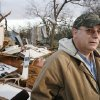 John Taliaferro sees the remains of his furniture store in first light after Tuesday\'s deadly tornado in Lone Grove, Okla. on Wednesday, Feb. 11, 2009. Photo by Steve Sisney, The Oklahoman