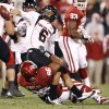 Graham Harrell of Texas Tech tries to get rid of the ball as OU\'s Adrian Taylor tries to bring him down during the college football game between the University of Oklahoma Sooners and Texas Tech University at Gaylord Family -- Oklahoma Memorial Stadium in Norman, Okla., Saturday, Nov. 22, 2008. BY BRYAN TERRY, THE OKLAHOMAN