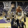 Photo - Kansas State's Thomas Gipson blocks a shot by West Virginia's Kevin Noreen (34) during the first half of an NCAA college basketball game Saturday, Jan. 18, 2014, in Manhattan, Kan. (AP Photo/Charlie Riedel)