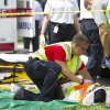 Rescue workers attend to a victim after a section of a parking garage under construction at a Miami-Dade College campus collapsed, Wednesday, Oct. 10, 2012 in Doral, Fla., killing one worker and trapping at least two others in the rubble, officials said. (AP Photo/J Pat Carter)