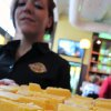 Photo -   Server Stephanie LaPhilliph holds a tray of 40-year-old cheddar on Saturday, Oct. 6, 2012 during a cheese tasting at Wisconsin Cheese Mart in Milwaukee. Many who tried it said it was smooth and with a clean finish. (AP Photo/Carrie Antlfinger)